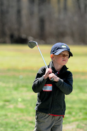 JIM VAIKNORAS/Staff photo  Kenny McCann 5, of Boxford gets ready to hit the ball during a golf clinic at Middleton Golf Course during vacation week.