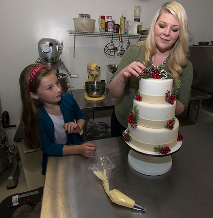 JIM VAIKNORAS/Staff photoTara Canaday and her daughter  Alexis Canaday at Tara Liegh Bakery in Middleton.
