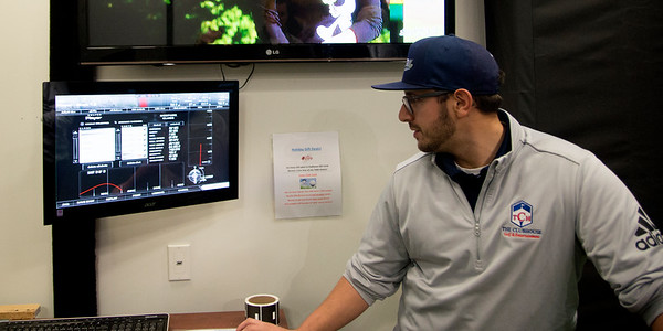 JIM VAIKNORAS/Staff photo Eddie Montone, Staff Teaching Professional  on one of the golf simulators