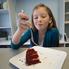 JIM VAIKNORAS/Staff photo Alexis Canaday eats piece of Red Velvet Cake at Tara Liegh Bakery in Middleton.