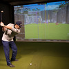 JIM VAIKNORAS/Staff photo Eddie Montone, Staff Teaching Professional the Club House in Middleton tees off on one of the golf simulators