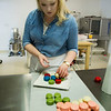 JIM VAIKNORAS/Staff photo Tara Leigh makes macaroons at her cake shop in Middleton