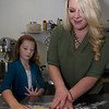 JIM VAIKNORAS/Staff photo Tara Leigh Canady  and her daughter Alexis , 8, make cookies at her bakery in Middleton.