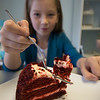JIM VAIKNORAS/Staff photo Alexis  eats piece of Red Velvet Cake at Tara Leigh Cakes in Middleton.