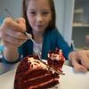 JIM VAIKNORAS/Staff photo Alexis  eats piece of Red Velvet Cake at Tara Leigh Cakes in Middleton.