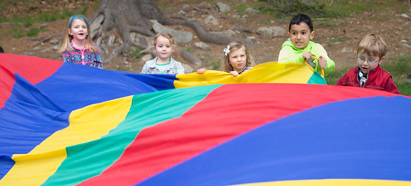 JIM VAIKNORAS photo Kids play with a parachute at Creighton Pond Earth Day celebration in Middleton.