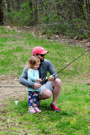 JIM VAIKNORAS photo Addison Gigliotti , 2, and her dad Marc of Middleton fish at Creighton Pond Earth Day celebration in Middleton.