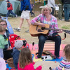 JIM VAIKNORAS photo Amy Chin of SoundPlay performs  at Creighton Pond Earth Day celebration in Middleton.