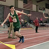 The Midland Wachusett Division B League Meet was held at Fitchburg High School Saturday, Feb. 1, 2020. Nashoba Regional High School's #421 Alexander Berube gets ready to take the baton from teammate #432 Fletcher Hohn as they compete in the 4x800 to start the meet off. SENTINEL & ENTERPRISE/JOHN LOVE