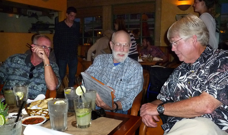 JIM, SHERMAN, AND PETE AT THE CLASS DINNER. SHERM IS CHECKING OUT A NEW iPAD.