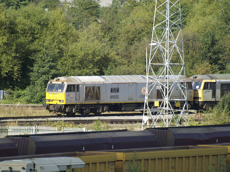 60033 is seen on the headshunt at Toton still in Corus livery