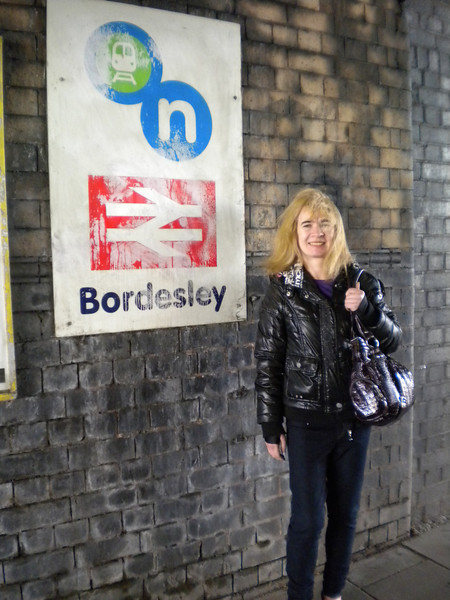 Liz posses next to the sign at Bordesley im standing in the bus shelter when i took this pic so it shows as i said how obscured the actual entrance is<br /> <br /> Ghost Station # 6 <br /> <br /> ok it was locked up but at least she seen it