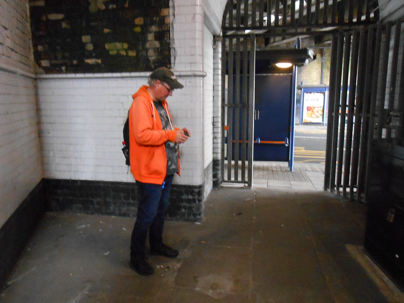 Ghost Station Man is caught checking his camera