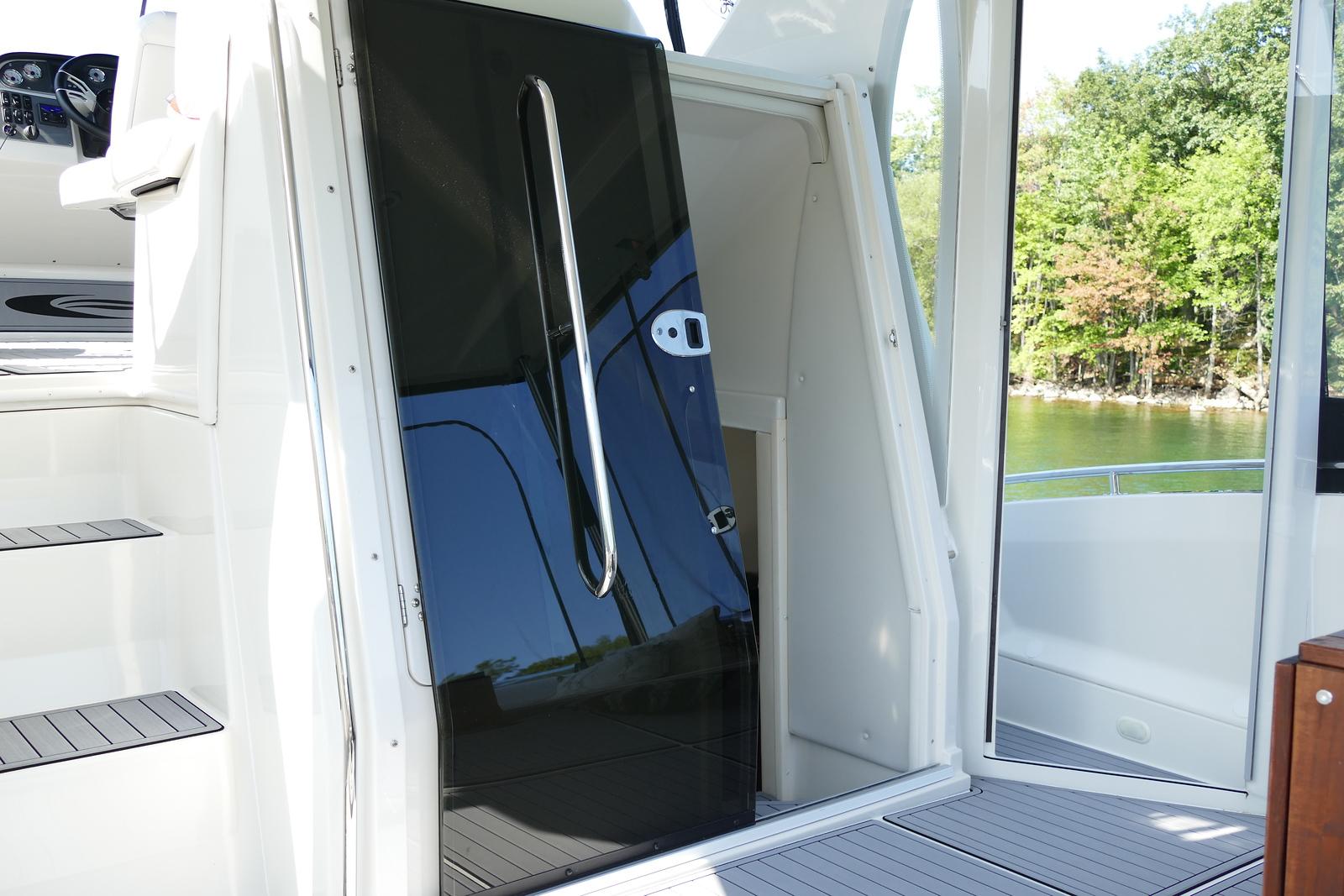 Entrance to the salon via sliding lexan door or on the lower deck via the patio door.