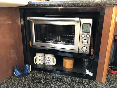Removed combo microwave. Enlarged opening, framed and installed Breville smart oven