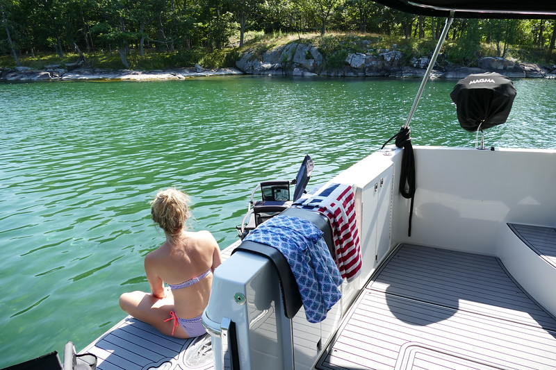 """Enjoying the clear warm waters of the 1000 Islands. About 4' deep here with sandy bottom. Boat only draws 2'6""""."""