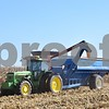 Corn kernels are augered into a grain cart after being harvested from Vince Faivre's field in DeKalb on Saturday.