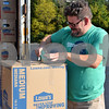 Volunteer Kyle White of Sycamore packages a box to be loaded onto the semitrailer full of supplies Sept. 15 at Crossview Church in DeKalb. The community donated more than 40,000 pounds of nonperishable items to aid in the American Red Cross' Hurricane Harvey relief efforts.