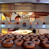 Katrina J.E. Milton - kmilton@shawmedia.com<br /> Susan Eichelberger (left) and Melissa Muetze make apple cider doughnuts on Aug. 31, the first day Honey Hill Orchard, 11783 Waterman Road in Waterman, opened for the season.