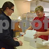 Katrina J.E. Milton - kmilton@shawmedia.com<br /> Margo Witzel of Sycamore (left)  purchases two dozen apple cider doughnuts from Terry Sandberg at Jonamac Orchard, 19412 Shabbona Road in Malta, to bring to work on Sept. 1. Witzel used to work at Jonamac Orchard when she was a student at Northern Illinois University, and she often returns to the orchard to purchase her favorite doughnuts.