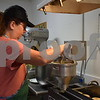 Katrina J.E. Milton - kmilton@shawmedia.com<br /> Melissa Muetze, a baker at Honey Hill Orchard, 11783 Waterman Road in Waterman, adds dough to be dropped into oil and fried to make apple cider doughnuts on the orchard's opening day, Aug. 31.