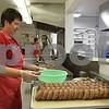 Katrina J.E. Milton - kmilton@shawmedia.com<br /> Denice McArtor makes apple cider doughnuts early on Sept. 1 at Jonamac Orchard, 19412 Shabbona Road in Malta. McArtor created her doughnut recipe more than 21 years ago and continues to use the same tried-and-true recipe every year.