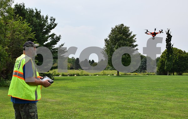 Bob Myers of DeKalb, the owner and operator of Hawk Aerial Imagery, flies his Yuneek Typhoon H drone on Aug. 3 at Afton Forest Preserve. Myers has his remote pilot certification and uses his drones to take pictures for the Joiner History Room in Sycamore, events, such as the DeKalb County Barn Tour, and for businesses, such as local real estate agencies.