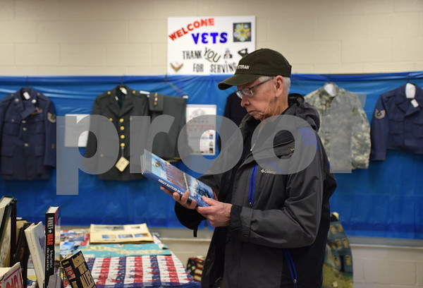 Jim Johnson of DeKalb, a Navy Korean War veteran who served from 1952 to 1956, looks at a book for sale in the veterans room at the Gifts, Treasures and Treats rummage sale at First United Methodist Church of DeKalb on Saturday. All of the proceeds from the veterans room will benefit the upcoming 2018 VetsRoll Inc. trip to Washington, D.C.