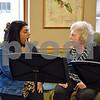Christina Abraham (left), a Northern Illinois University graduated student in the speech-language pathology program, helps Bridges Choir member Dorothee Aves of DeKalb with vocalizations during a concert Sunday at DeKalb Area Retirement Center – Oak Crest.