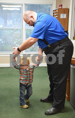 Two-year-old Clark Cutler of Malta, pictured practicing walking with his father Jason, has been diagnosed with Pelizaeus-Merzbacher disease, a type of leukodystrophy. Because of his young age, it is unknown whether Clark will be able to walk or talk, but his family travels with him to Indiana and Chicago to see doctors and specialists and he attends physical, occupational and speech therapies. He also attends hippotherapy, or therapy on horseback, at Heightened Potential Co. in Kirkland.