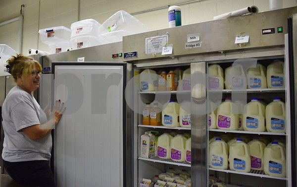 Sheryl Nakonechny, executive director of Barb Food Mart in DeKalb, shows the food pantry's milk refrigerator. Barb Food Mart received $9,500 from 100+ Women Who Care DeKalb/Sycamore in August 2015 to help purchase milk.