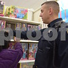 DeKalb Police Sgt. Tony Kwasniewski helps 9-year-old Tyjaya Frierson shop during the Heroes and Helpers event Sunday at Target in DeKalb. Thirteen DeKalb police officers volunteered to help with the event, which provided 38 children in DeKalb School District 428 the opportunity to choose and take home more than $100 in Christmas presents each.
