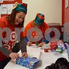 Nina Contreras of Chicago (left) and her aunt, Migdalia Oquendo of Puerto Rico, were two of more than 30 volunteers who helped wrap gifts purchased during the Heroes and Helpers event at Target in DeKalb on Sunday. Contreras' sister works at the store, and she decided to volunteer with her aunt after learning about how the event helps children in need during the Christmas season.