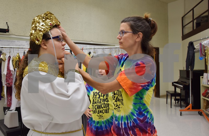 """Before rehearsal on Sept. 22, Tricia Steele of St. Charles (right), a volunteer with Children's Community Theater's Penguin Project, adjusts the headpiece of the Egyptian costume of Sarah Lehan of DeKalb, 19. Lehan and a cast of 61 others will perform CCT's Penguin Project's """"Joseph and the Amazing Technicolor Dreamcoat"""" at Sycamore High School this weekend."""