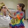 "Before rehearsal on Sept. 22, Tricia Steele of St. Charles (right), a volunteer with Children's Community Theater's Penguin Project, adjusts the headpiece of the Egyptian costume of Sarah Lehan of DeKalb, 19. Lehan and a cast of 61 others will perform CCT's Penguin Project's ""Joseph and the Amazing Technicolor Dreamcoat"" at Sycamore High School this weekend."