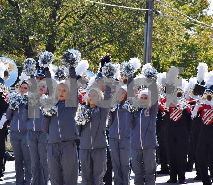 The NIU Silverettes Dance Team and NIU Huskie Marching Band perform during the 56th annual Sycamore Pumpkin Festival Parade on Sunday.