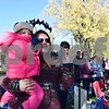 Sarah Rexford of Lombard holds her 1-year-old daughter Adeline as they wave to passing floats during the 56th annual Sycamore Pumpkin Festival's parade on Sunday. Rexford and her family are in the process of moving to Sycamore and decided to attend the Sycamore Pumpkin Festival Parade to learn more about their new hometown.