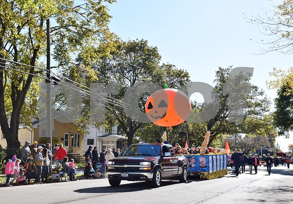 The 56th annual Sycamore Pumpkin Festival Parade on Sunday featured about 122 entries, including floats created by local businesses, banks, sports teams, church groups, dance troupes and nonprofit organizations, 16 marching bands, and a Tate & Lyle float, pictured.