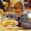 Everett Fredrickson of Sycamore, 7, eats a plate of food during the free community Thanksgiving dinner Sunday at the Evangelical Lutheran Church of St. John in Sycamore.