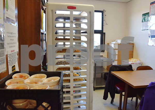 Freshly baked biscuits and individual portions of fruit cups take up more than half of the room inside Voluntary Action Center's staff break room. Walking past furniture, boxes and stacked food requires side steps and shimmying in order not to bump into or knock anything over.