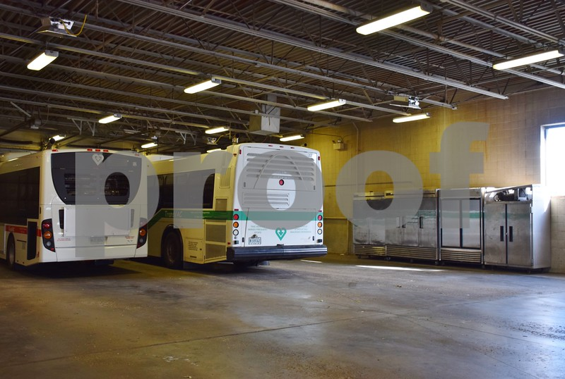 Refrigerators and freezers line the wall of TransVAC's bus garage because of the lack of space inside Voluntary Action Center's kitchen building.