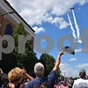 Katrina J.E. Milton - kmilton@shawmedia.com<br /> The crowd cheers Sunday during the opening ceremony of the 18th annual Fizz Ehrler Memorial Turning Back Time Car Show, as 1940s Boeing Stearman biplanes flown by Scott Carlson and Claude Sunday fly over downtown Sycamore.
