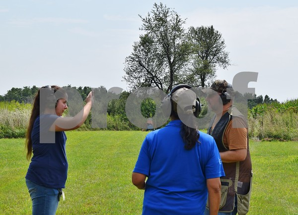 Katrina J.E. Milton - kmilton@shawmedia.com<br /> Misty Underhill of Algonquin (left) has her eye dominance checked by Illinois Department of Natural Resources instructor Nancy Donaldson and instructor candidate Ed Anderson on Aug. 20, during the Shabbona Lake Youth and Women's Wingshooting Clinic.