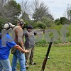 Katrina J.E. Milton - kmilton@shawmedia.com<br /> Kim Duda of DeKalb (right) prepares to shoot at a clay pigeon with a 28-gauge semi-automatic shotgun on Aug. 20, during the Shabbona Lake Youth and Women's Wingshooting Clinic. She is pictured (from left) with Illinois Department of Natural Resources instructor Nancy Donaldson and instructor candidate Ed Anderson.