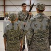 Katrina J.E. Milton - kmilton@shawmedia.com<br /> Civil Air Patrol Captain Ethan Peterman of DeKalb (center) demonstrates to cadets how to hold a rifle during a color guard ceremony during a Sept. 8 meeting at DeKalb Taylor Municipal Airport.