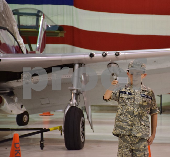 Katrina J.E. Milton - kmilton@shawmedia.com<br /> Cadet Travis Dulzo of DeKalb, 12, recites the Civil Air Patrol Cadet Program oath during a meeting on Sept. 8 at DeKalb Taylor Municipal Airport. In the oath, cadets vow to attend meetings regularly, participate actively in unit activities, obey officers, wear their uniform properly and advance their education and training rapidly in preparation to be of service to their community, state and nation.