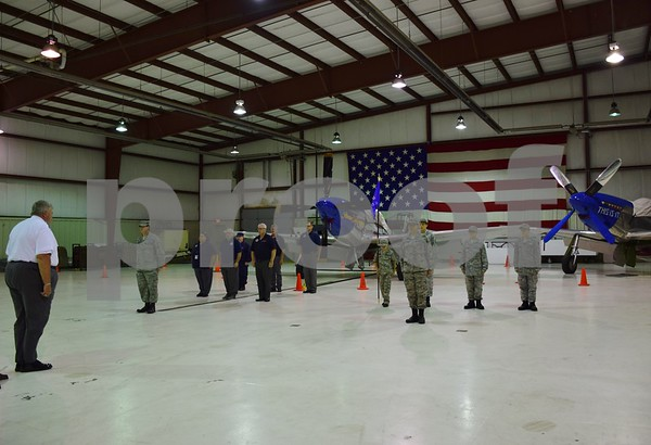 Katrina J.E. Milton - kmilton@shawmedia.com<br /> Major Steven Weber, commander of the DeKalb County Composite Civil Air Patrol Squadron, leads formation practice of senior members (left) and cadets (right) during a meeting on Sept. 8 at DeKalb Taylor Municipal Airport.