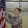 Katrina J.E. Milton - kmilton@shawmedia.com<br /> Blake Starzyk of DeKalb, 14, a cadet with the DeKalb County Composite Civil Air Patrol Squadron, adjusts an American flag during color guard practice at the group's Sept. 8 meeting at DeKalb Taylor Municipal Airport. Starzyk, who joined the DeKalb County Composite Civil Air Patrol Squadron in May, said that since becoming a cadet, he now plans to join the Air Force after high school.
