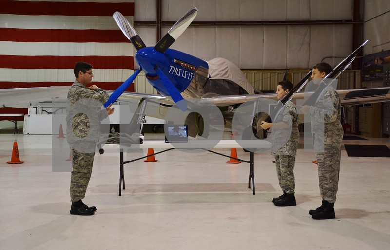 Katrina J.E. Milton - kmilton@shawmedia.com<br /> Civil Air Patrol Captain Ethan Peterman of DeKalb demonstrates how to hold a rifle during a color guard ceremony at the group's Sept. 8 meeting at DeKalb Taylor Municipal Airport. From left are Captain Ethan Peterman, Cadet Jonathan Lunsmann, 12, of Batavia and Blake Starzyk, 14, of DeKalb.