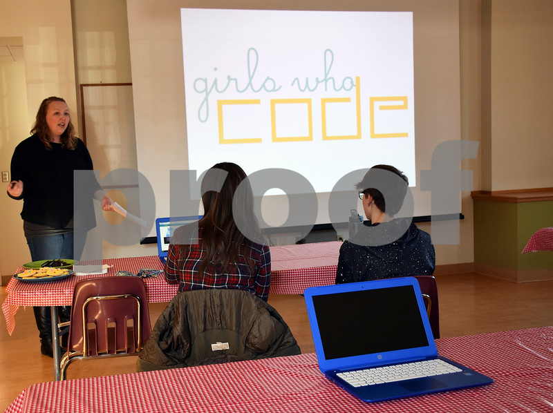 Erin Arnold of Sycamore leads an introductory meeting of Girls Who Code on Saturday at the Sycamore Public Library. The newly formed group is part of the nonprofit organization Girls Who Code, which has more than 40,000 members in all 50 states.